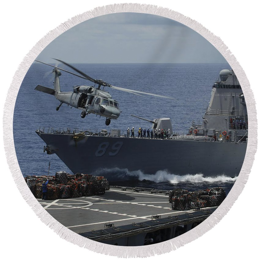 Uss Essex Round Beach Towel featuring the photograph An Mh-60s Knighthawk Helicopter by Stocktrek Images