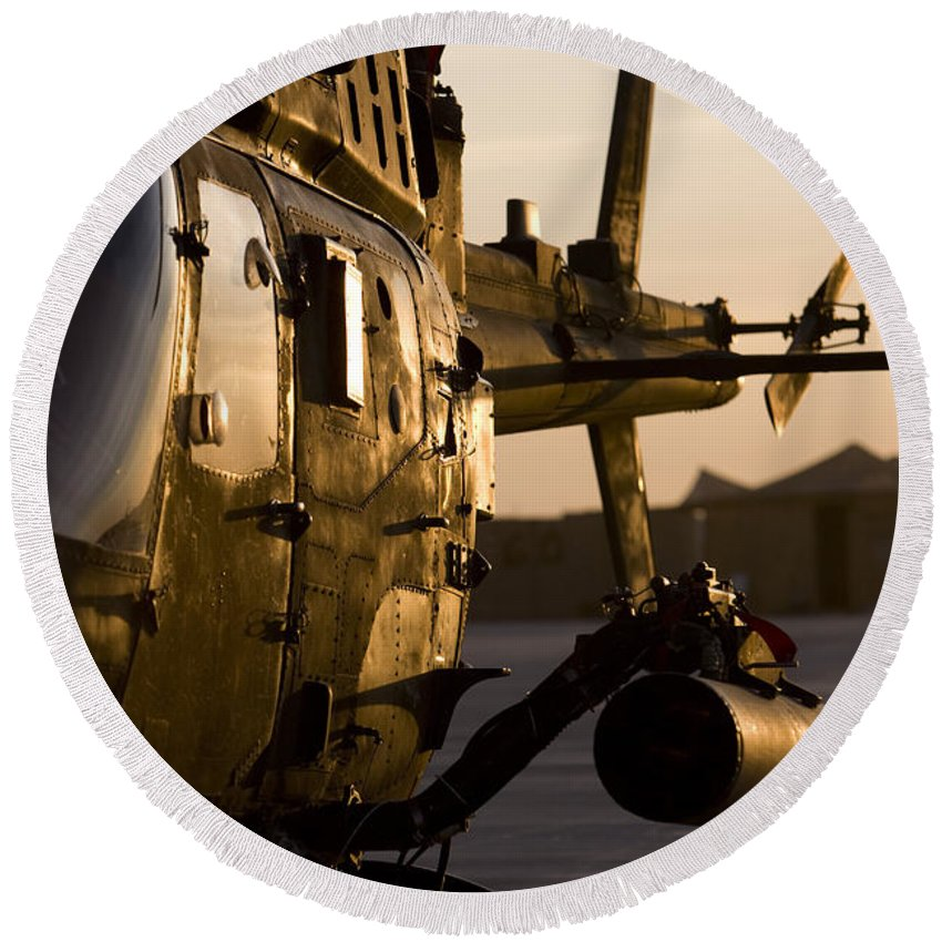 Aviation Round Beach Towel featuring the photograph An Oh-58d Kiowa During Sunset by Terry Moore