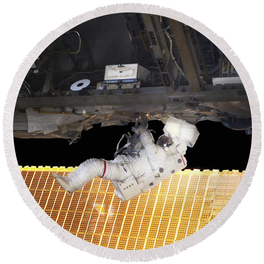 Adults Only Round Beach Towel featuring the photograph Astronaut Participates In A Spacewalk by Stocktrek Images