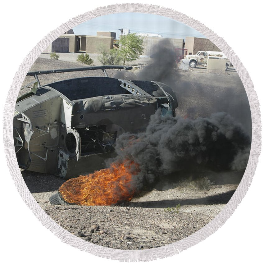 Salvage Round Beach Towel featuring the photograph Black Smoke Rises To The Air by Stocktrek Images