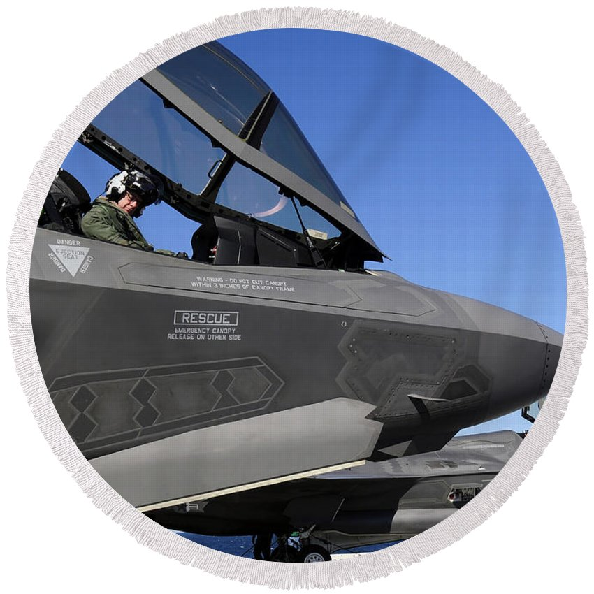 Aerospace Round Beach Towel featuring the photograph F-35b Lightning II Variants Are Secured by Stocktrek Images