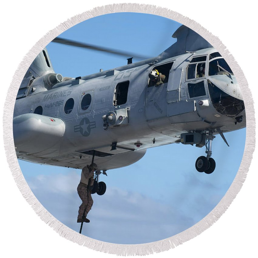Military Round Beach Towel featuring the photograph Marines Fast Rope From A Ch-46 Sea by Stocktrek Images
