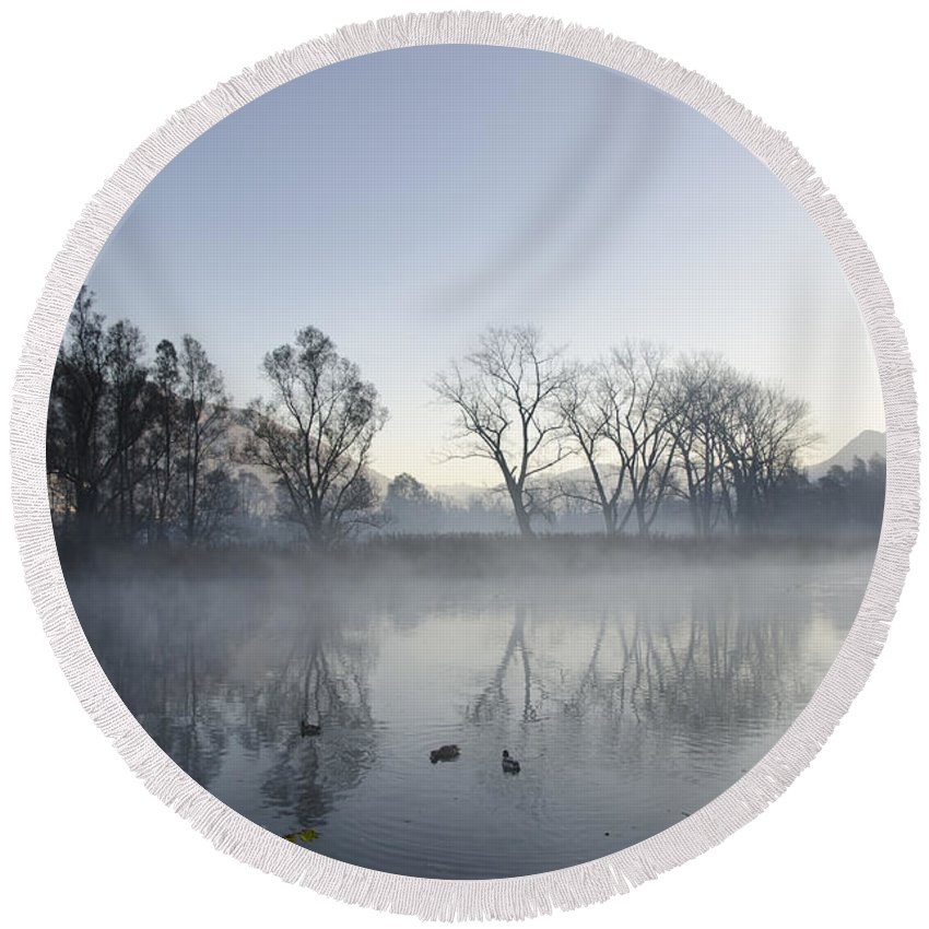 Lake Round Beach Towel featuring the photograph Mountain And Trees Reflected In A Foggy Lake by Mats Silvan