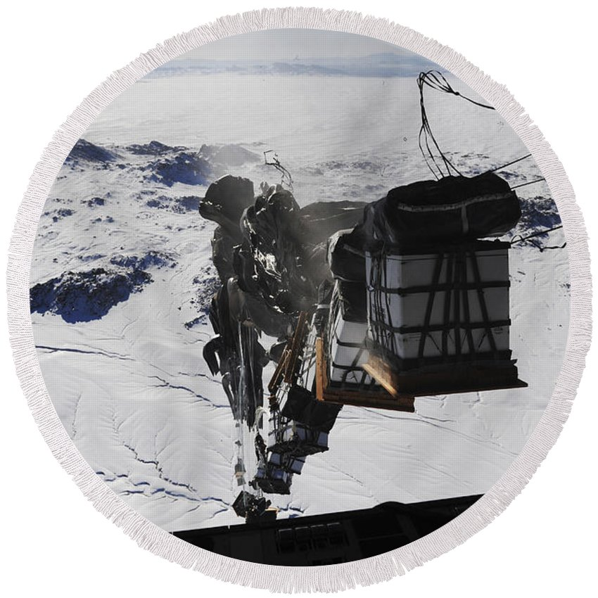 Air Force Round Beach Towel featuring the photograph Pallets Are Released From A C-130 by Stocktrek Images