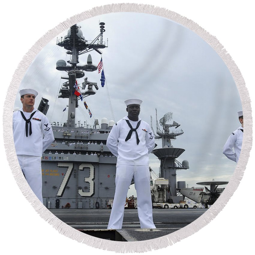 Uss George Washington Round Beach Towel featuring the photograph Sailors Man The Rails Aboard by Stocktrek Images