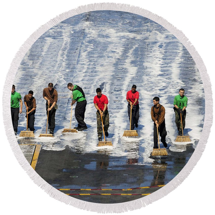 Maintenance Round Beach Towel featuring the photograph Sailors Perform A Flight Deck Wash by Stocktrek Images