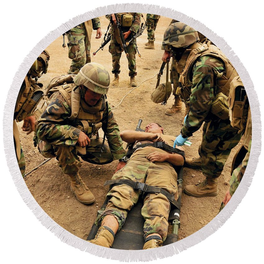 Naval Mobile Construction Battalion Round Beach Towel featuring the photograph Seabees Conduct A Mass Casualty Drill by Stocktrek Images
