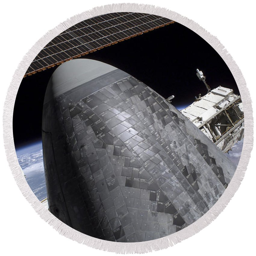 Blue Round Beach Towel featuring the photograph Space Shuttle Discovery Docked by Stocktrek Images
