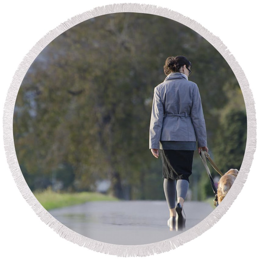 Woman Round Beach Towel featuring the photograph Woman Walking With Her Dogs by Mats Silvan