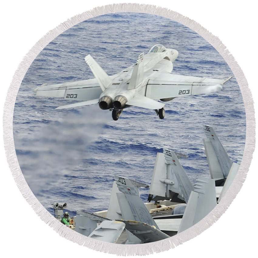 Uss George Washington Round Beach Towel featuring the photograph An Fa-18e Super Hornet Launches by Stocktrek Images