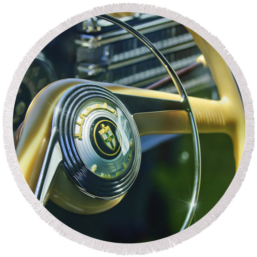 1942 Lincoln Continental Cabriolet Round Beach Towel featuring the photograph 1942 Lincoln Continental Cabriolet Steering Wheel Emblem by Jill Reger