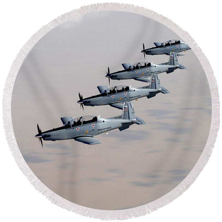 Trainer Round Beach Towel featuring the photograph A Formation Of Iraqi Air Force T-6 by Stocktrek Images