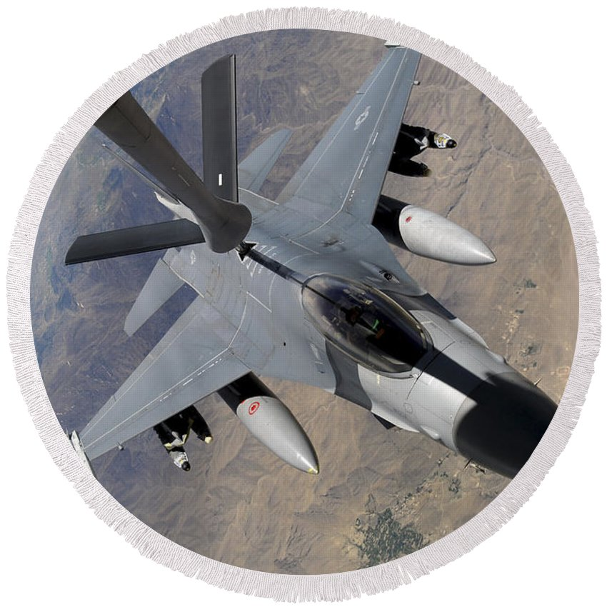 Afghanistan Round Beach Towel featuring the photograph An F-16 Fighting Falcon Receives Fuel by Stocktrek Images