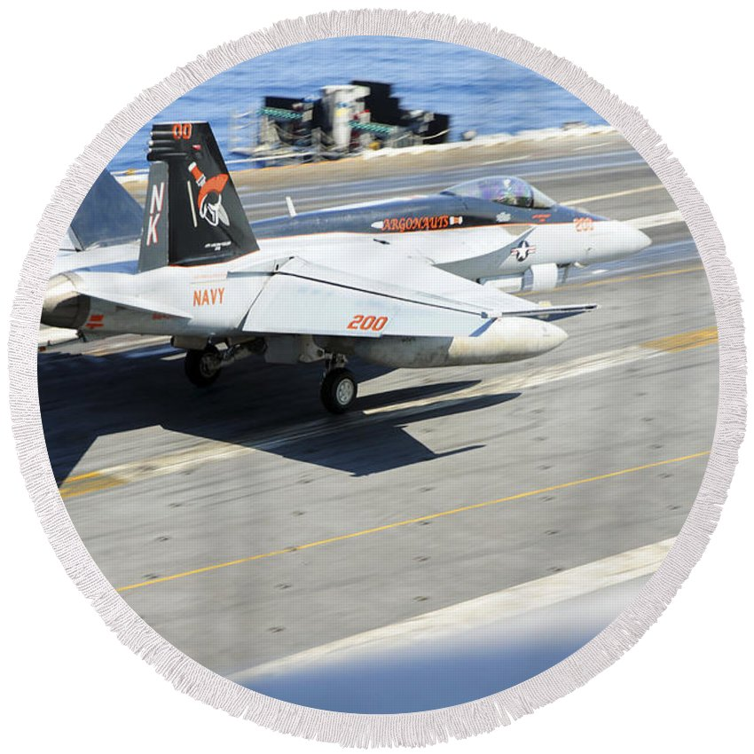 Aviation Round Beach Towel featuring the photograph An Fa-18e Super Hornet Lands Aboard by Stocktrek Images