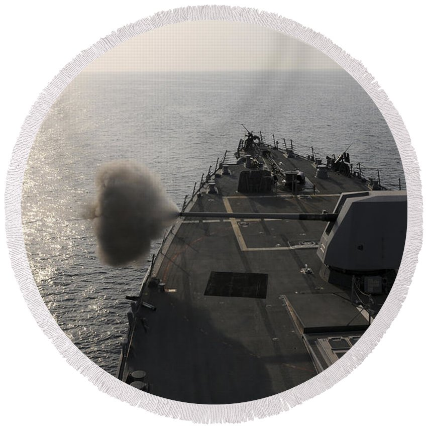 Reflection Round Beach Towel featuring the photograph An Mk-45 Lightweight Gun Is Fired by Stocktrek Images