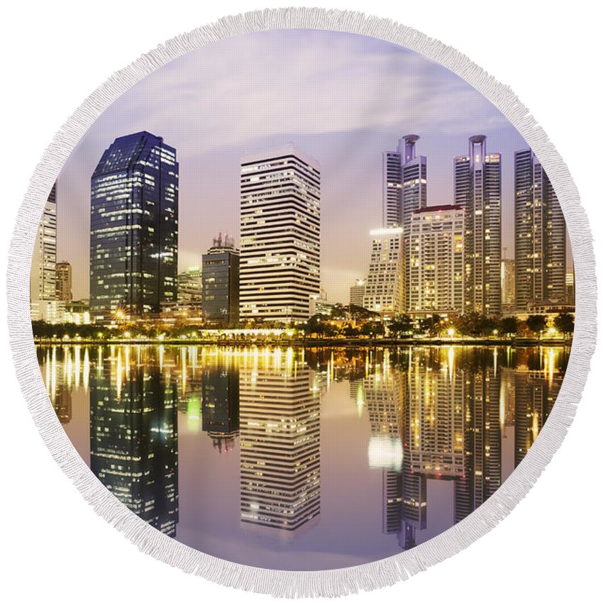 Architecture Round Beach Towel featuring the photograph Night Scenes Of City by Setsiri Silapasuwanchai