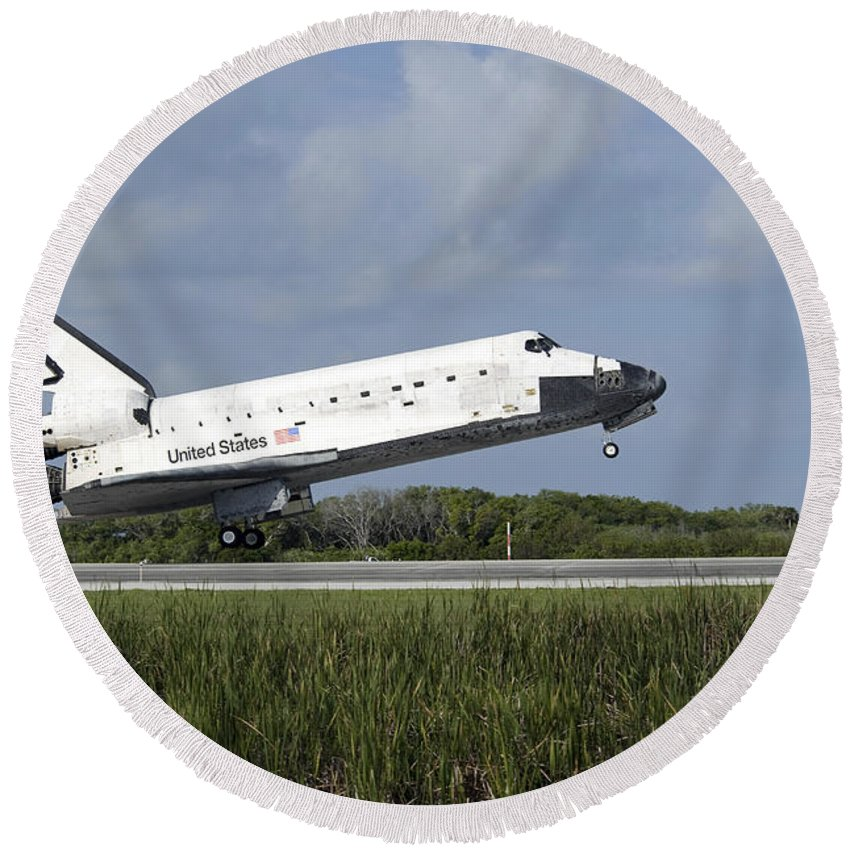 Sts-131 Round Beach Towel featuring the photograph Space Shuttle Discovery Lands On Runway by Stocktrek Images