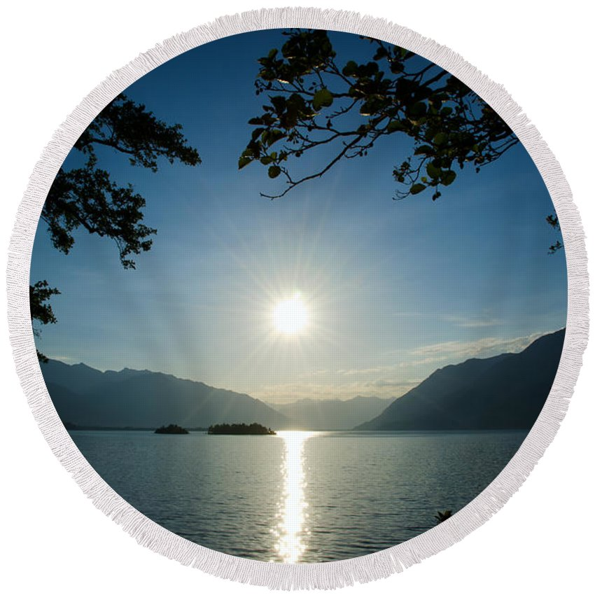 Sun Round Beach Towel featuring the photograph Sunshine Over An Alpine Lake by Mats Silvan