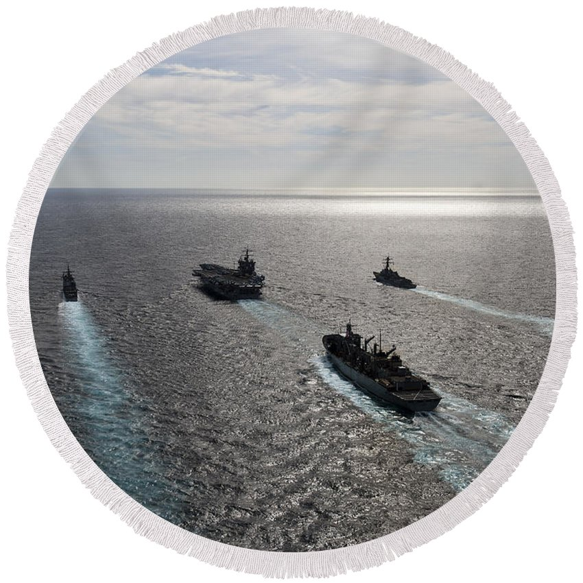 Atlantic Ocean Round Beach Towel featuring the photograph The Enterprise Carrier Strike Group by Stocktrek Images