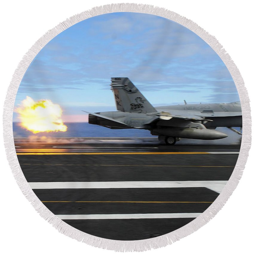 Flight Operations Round Beach Towel featuring the photograph An Fa-18c Hornet Launches by Stocktrek Images