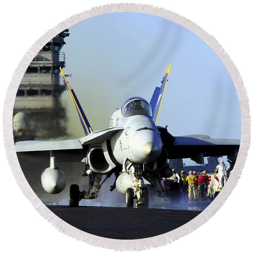 F/a-18 Hornet Round Beach Towel featuring the photograph An Fa-18c Hornet Launches by Stocktrek Images