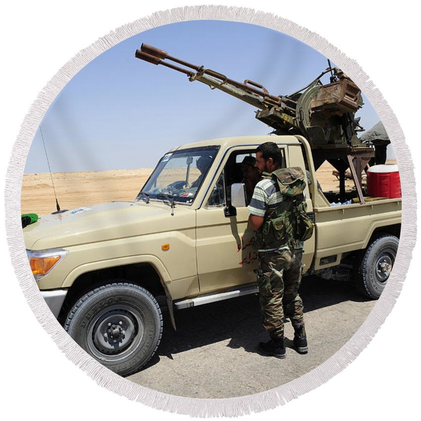 Ajadabiya Round Beach Towel featuring the photograph A Free Libyan Army Pickup Truck by Andrew Chittock