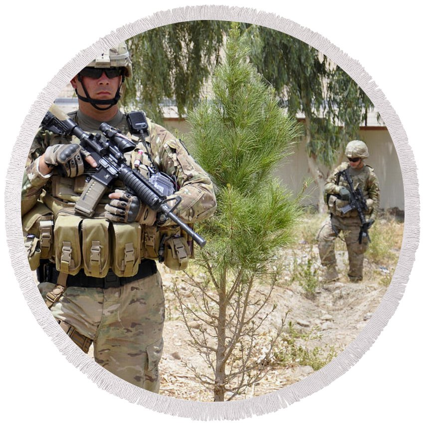 Operation Enduring Freedom Round Beach Towel featuring the photograph U.s. Army Soldier Stands Guard by Stocktrek Images
