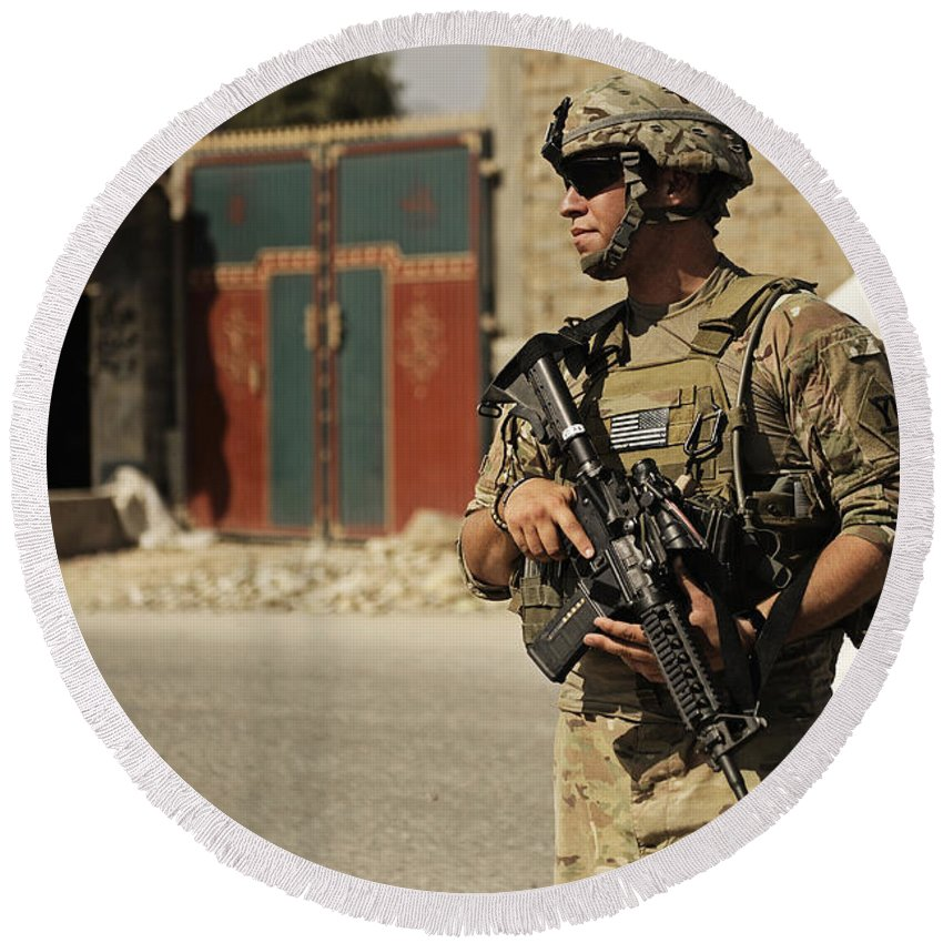 Security Forces Round Beach Towel featuring the photograph U.s. Army Specialist Provides Security by Stocktrek Images