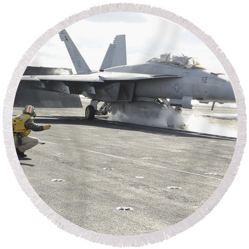 Military Round Beach Towel featuring the photograph An Fa-18f Super Hornet Launches by Stocktrek Images