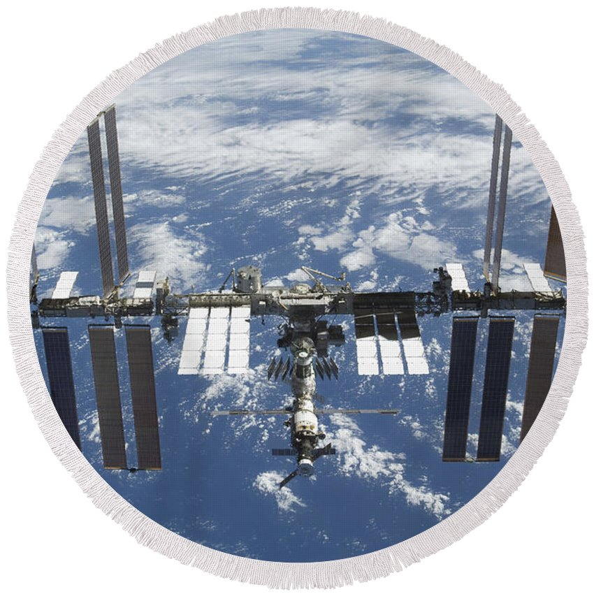 Terra Round Beach Towel featuring the photograph The International Space Station by Stocktrek Images