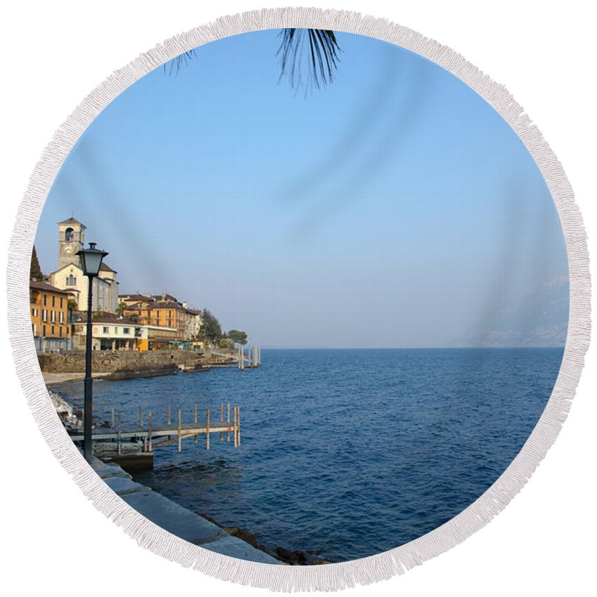 Vilage Round Beach Towel featuring the photograph Village On The Lake Front by Mats Silvan