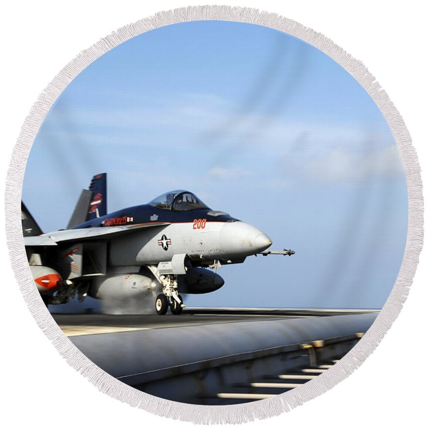 Uss Ronald Reagan Round Beach Towel featuring the photograph An Fa-18e Super Hornet Launches by Stocktrek Images