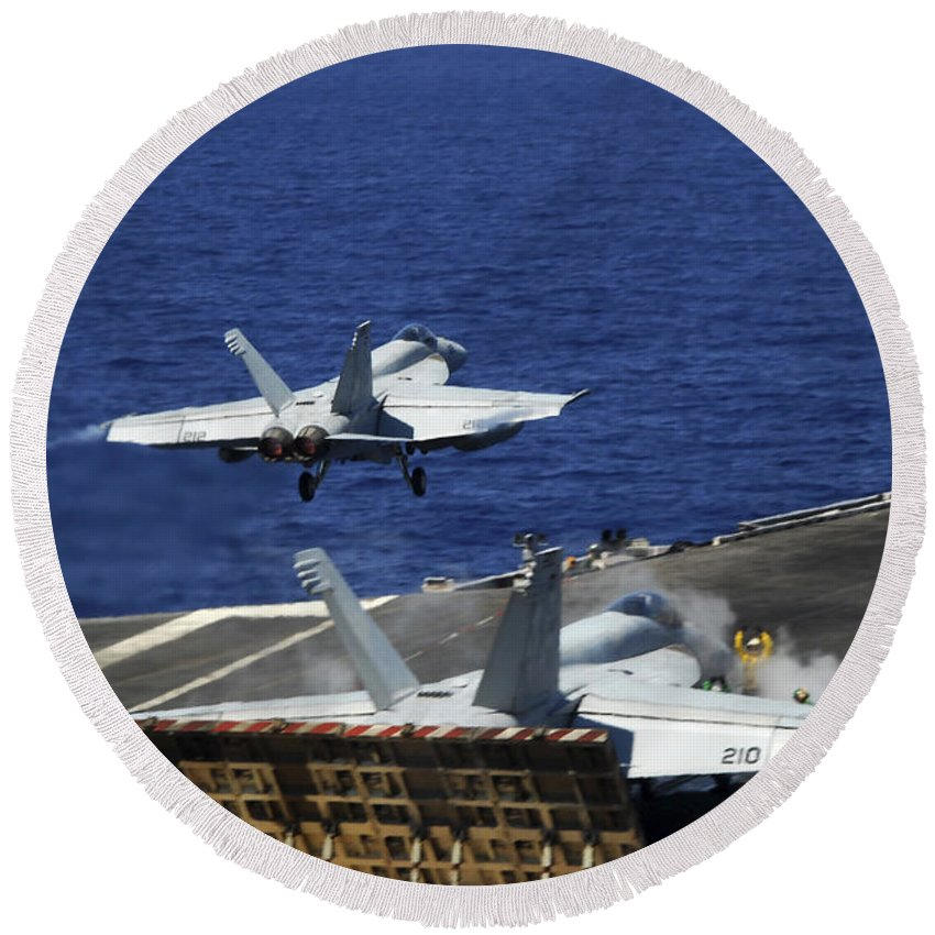 Flight Deck Round Beach Towel featuring the photograph An Fa-18e Super Hornet Launches by Stocktrek Images