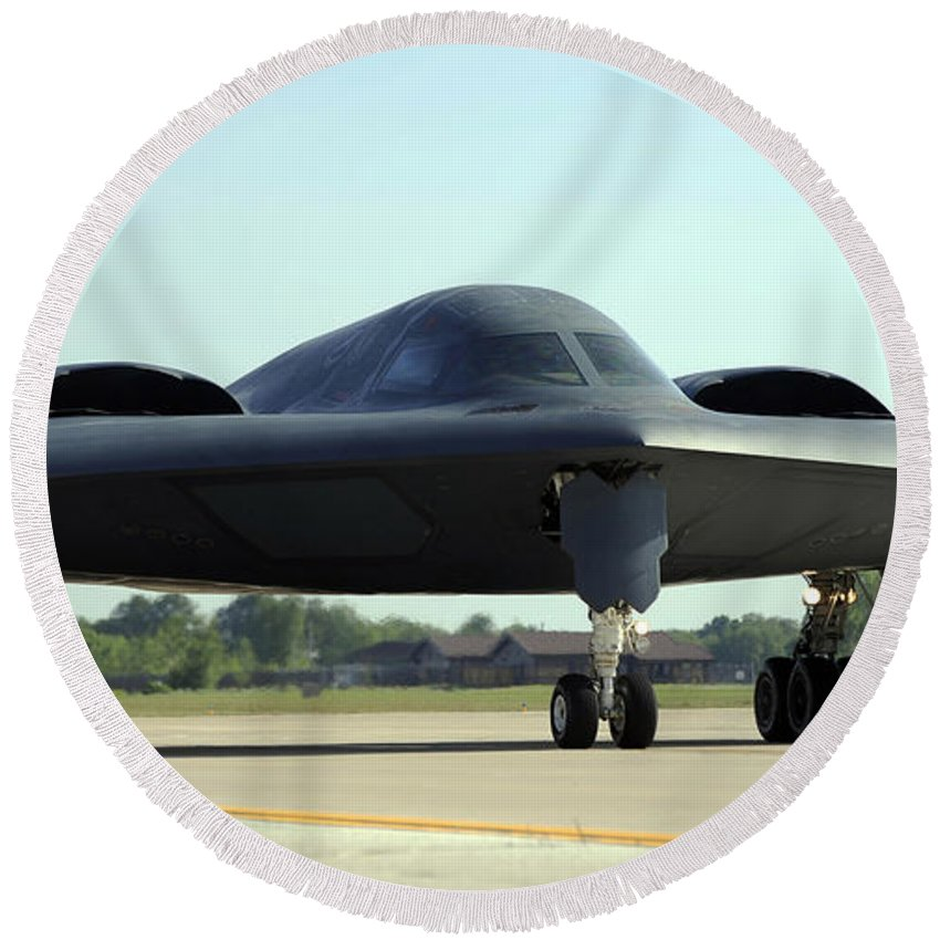 Missouri Round Beach Towel featuring the photograph A B-2 Spirit Taxis Onto The Flightline by Stocktrek Images