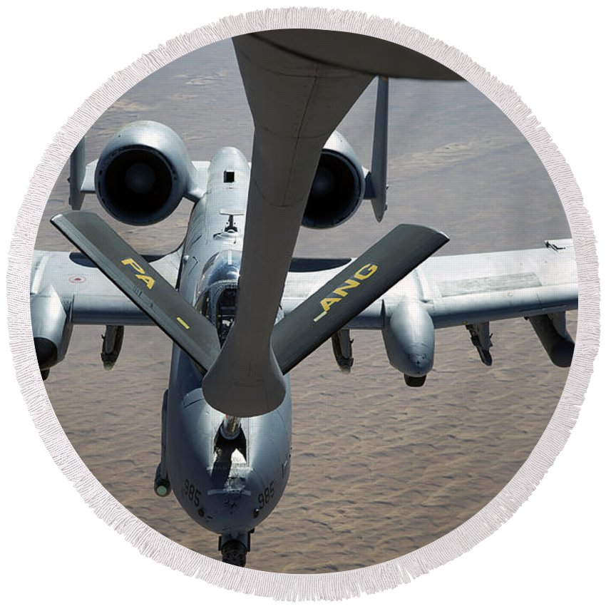 Aerial Refueling Round Beach Towel featuring the photograph A Boom Operator Refuels An A-10 by Stocktrek Images