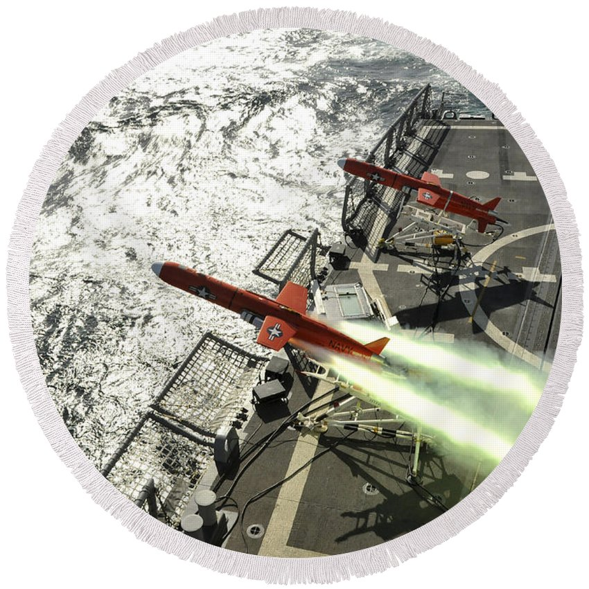 Weapon Round Beach Towel featuring the photograph A Bqm-74e Aerial Drone Launches by Stocktrek Images