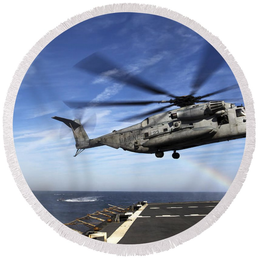 No People Round Beach Towel featuring the photograph A Ch-53e Super Stallion Prepares by Stocktrek Images