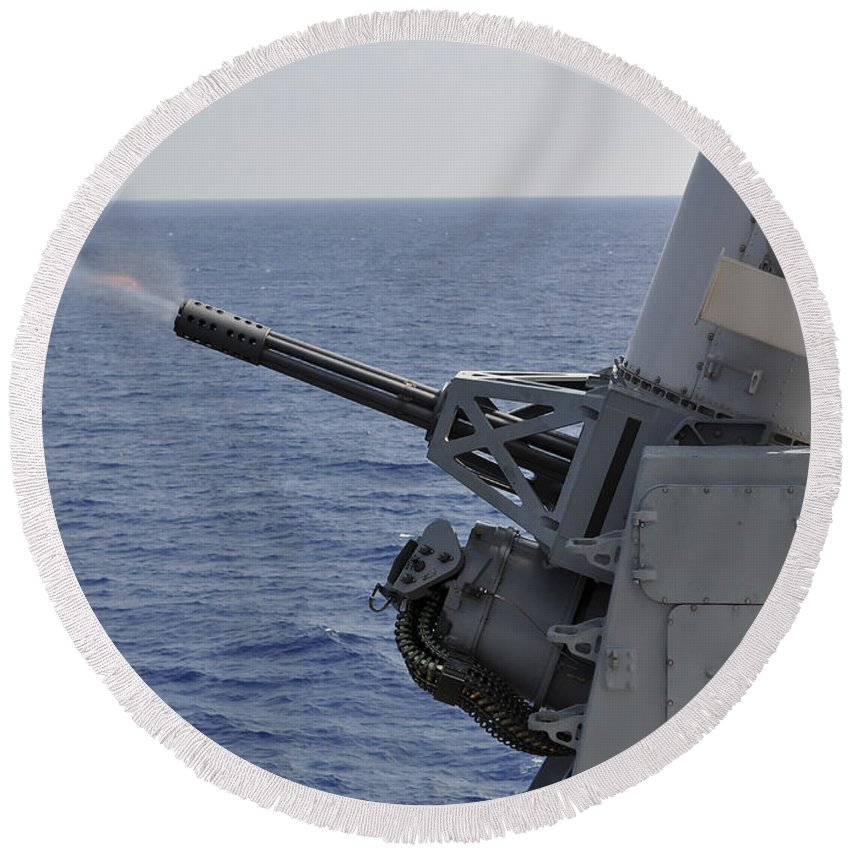 Weapon Systems Round Beach Towel featuring the photograph A Close-in Weapons System Aboard by Stocktrek Images
