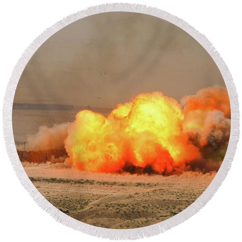 Dust Round Beach Towel featuring the photograph A Cloud Of Dust And Debris Rises by Stocktrek Images