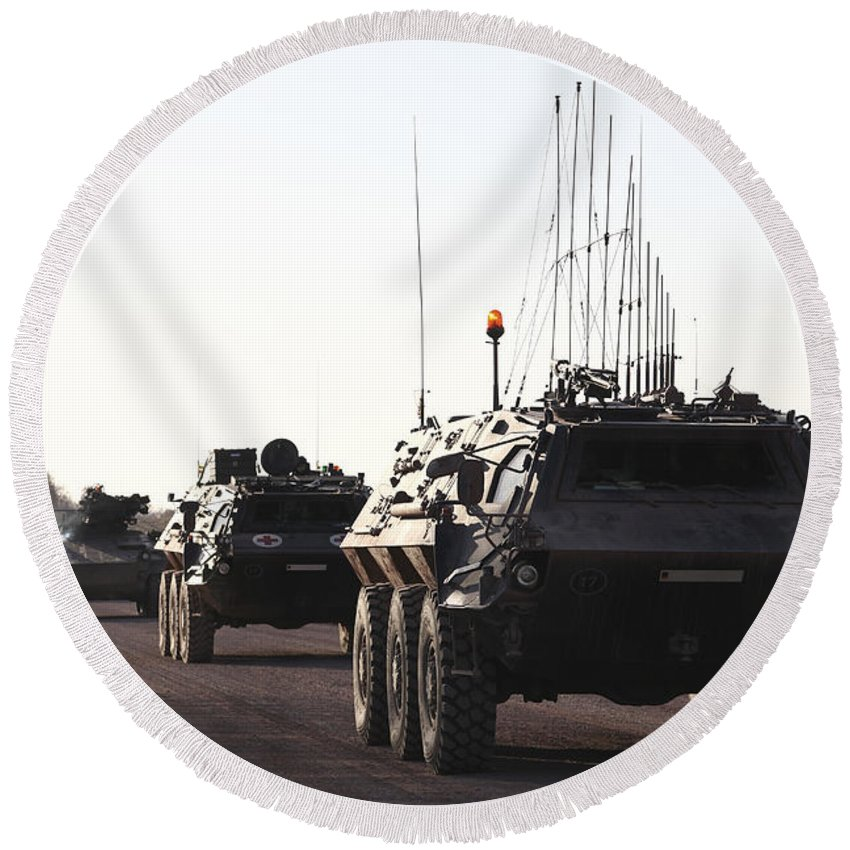 Germany Round Beach Towel featuring the photograph A Convoy Of German Army Tpz Fuchs by Timm Ziegenthaler