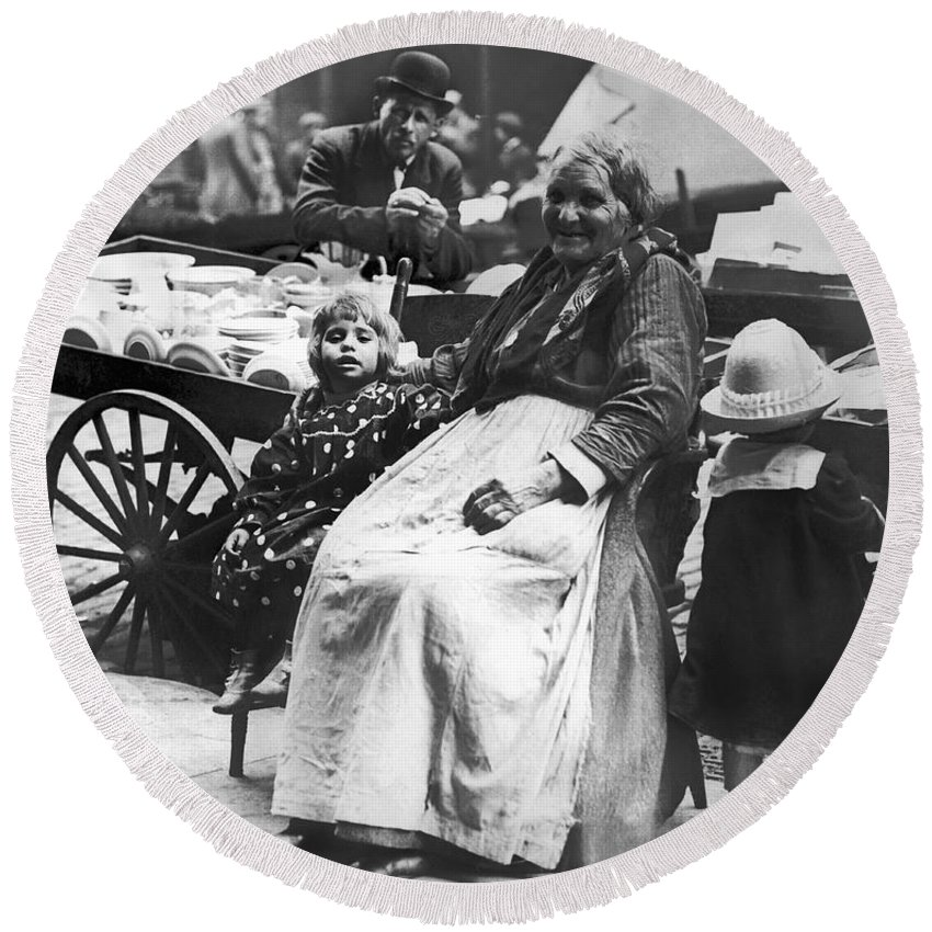1890 Round Beach Towel featuring the photograph A Family And Their Push Cart by Underwood Archives