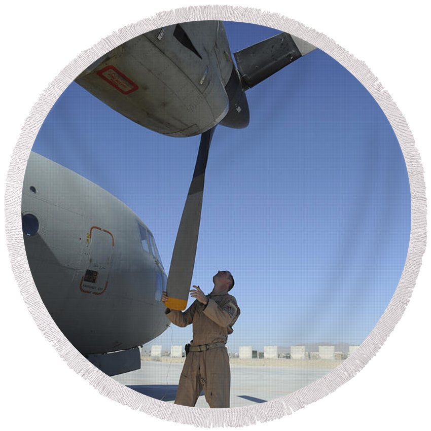 Afghanistan Round Beach Towel featuring the photograph A Flight Engineer Performs A Pre-flight by Stocktrek Images