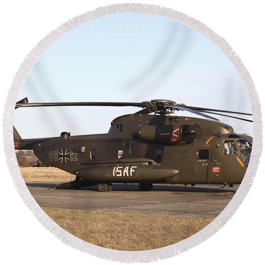 Germany Round Beach Towel featuring the photograph A German Ch-53gs Helicopter At Stendal by Timm Ziegenthaler