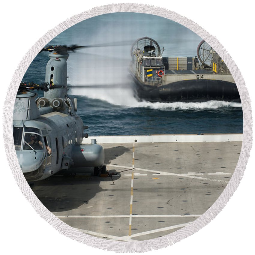 Military Round Beach Towel featuring the photograph A Hovercraft Approaches Uss New Orleans by Stocktrek Images