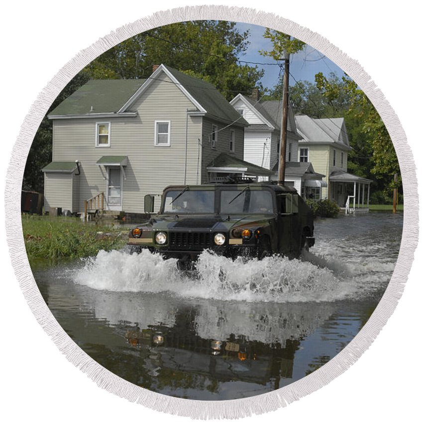 Suburb Round Beach Towel featuring the photograph A Humvee Drives Through The Floodwaters by Stocktrek Images
