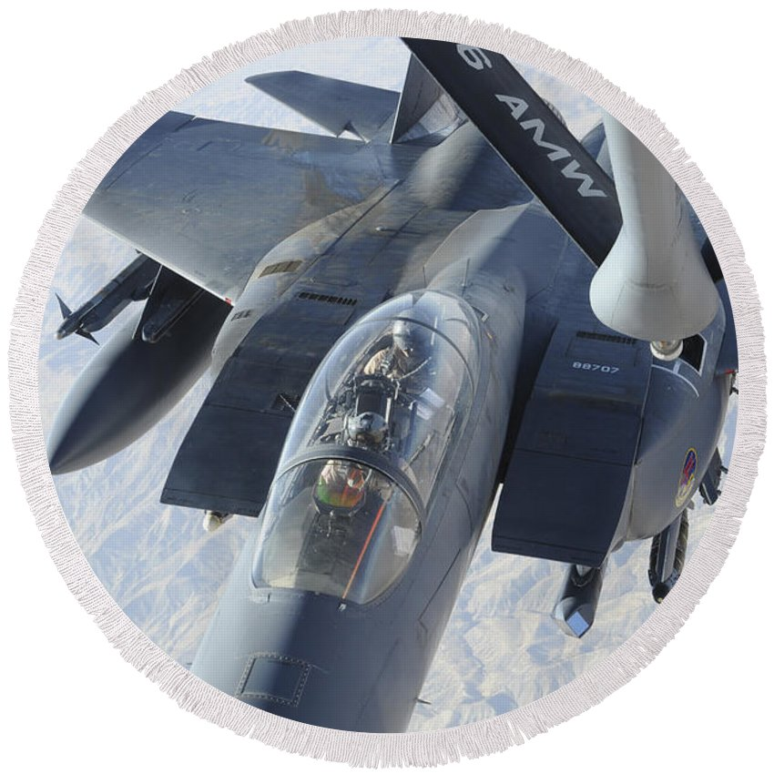 Kc-135 Stratotanker Round Beach Towel featuring the photograph A Kc-135 Stratotanker Refuels An F-15e by Stocktrek Images