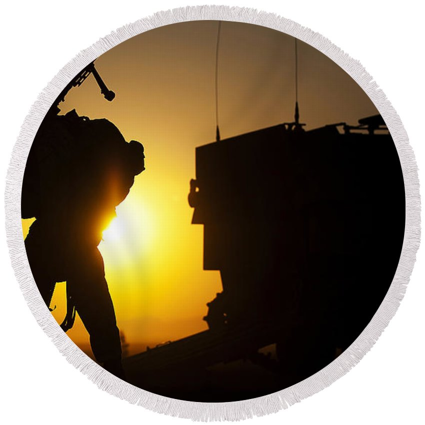 California Round Beach Towel featuring the photograph A Machine Gunner Prepares To Load An by