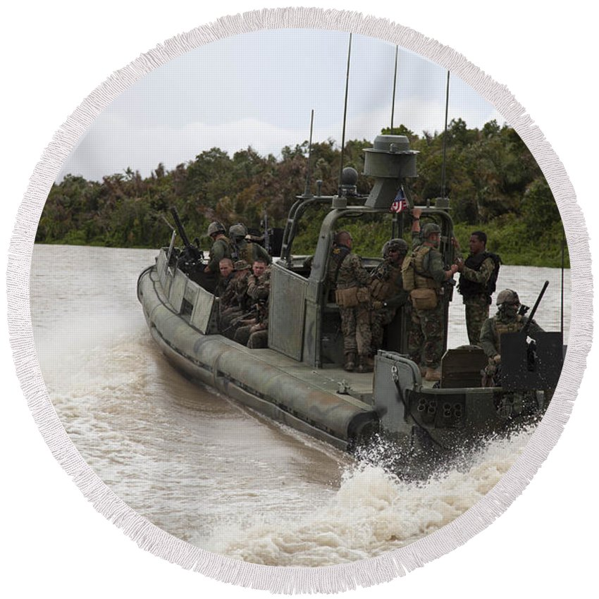 Battalion Round Beach Towel featuring the photograph A Navy Riverine Patrol Boat Conducts by Stocktrek Images