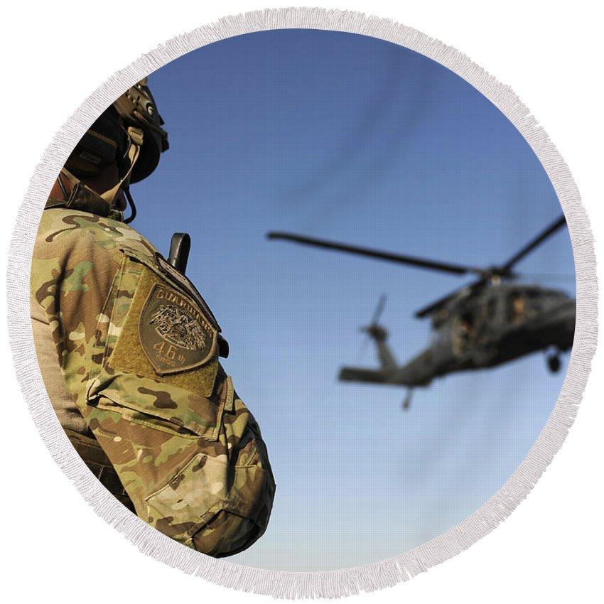 Afghanistan Round Beach Towel featuring the photograph A Pararescueman Awaits The Landing by Stocktrek Images