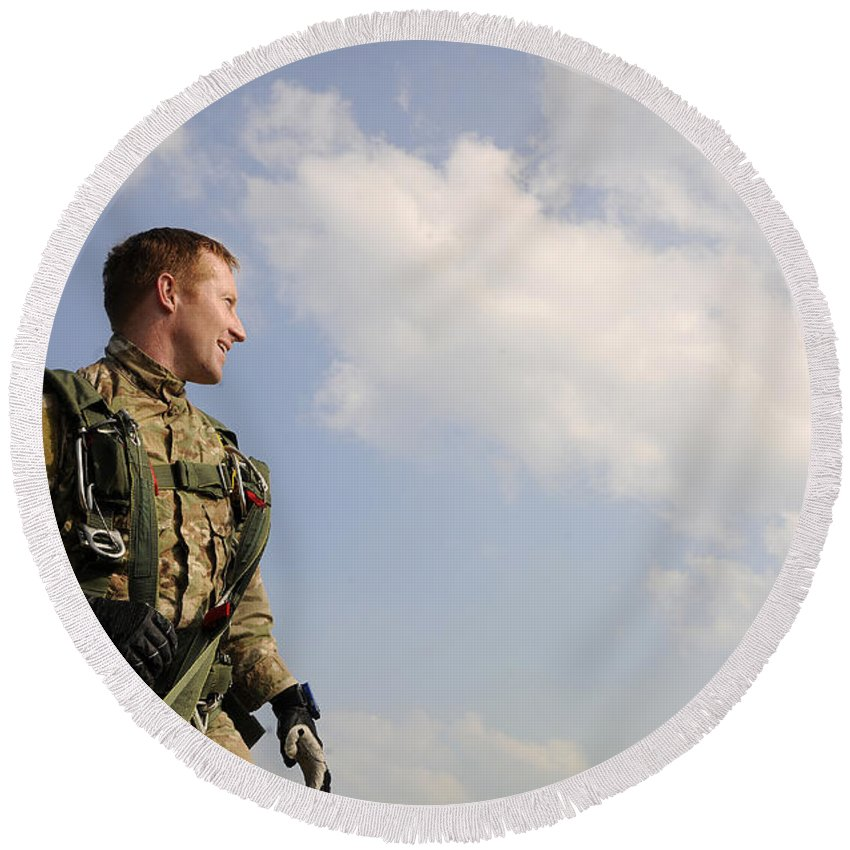 Instructor Round Beach Towel featuring the photograph A Paratrooper Looks On As Other by Stocktrek Images